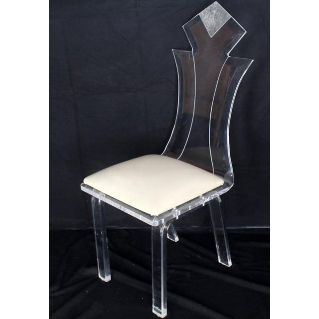 Very nice Mid-Century Modern set of carved beveled Lucite shield back style dining chairs.