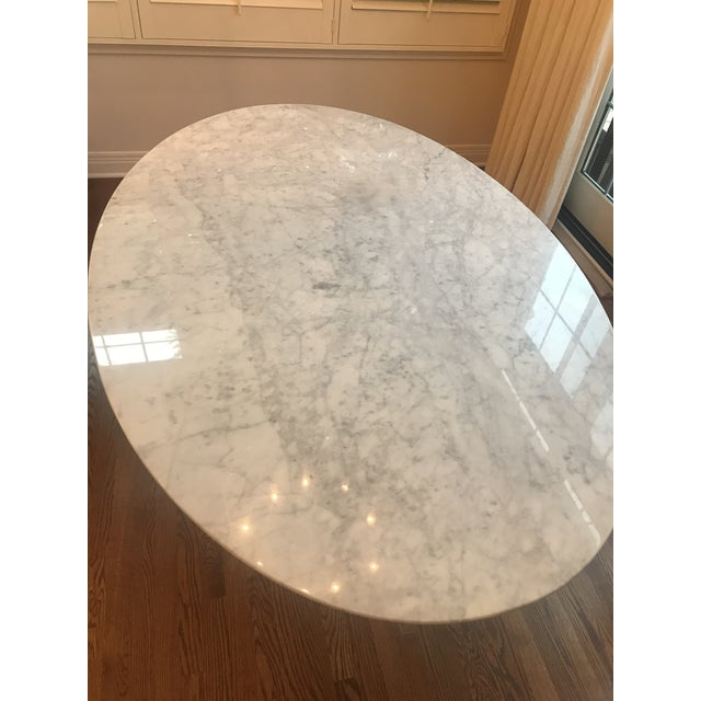 This beautiful and iconic oval shaped tulip table by France and Son was purchased and never used for the intended space,...