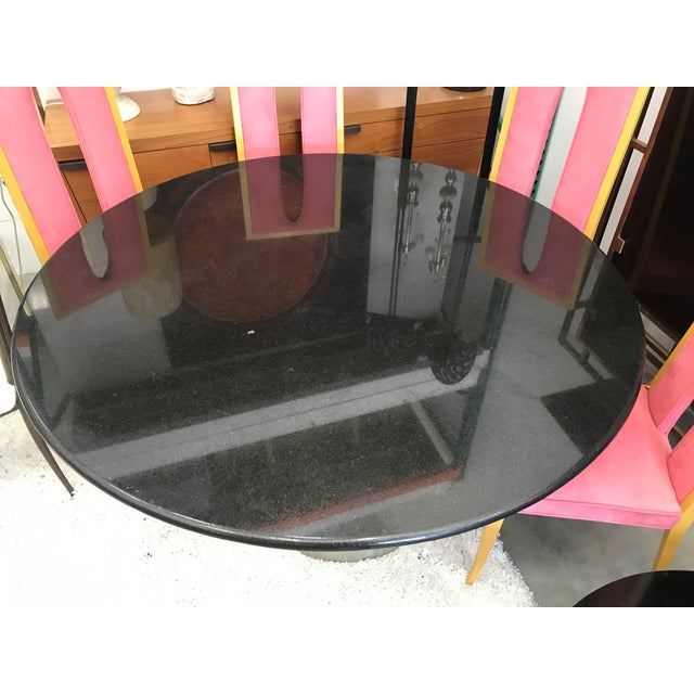 Beautiful dining table by Brueton with satin steel finish base and smooth round Italian black granite top. perfect for...