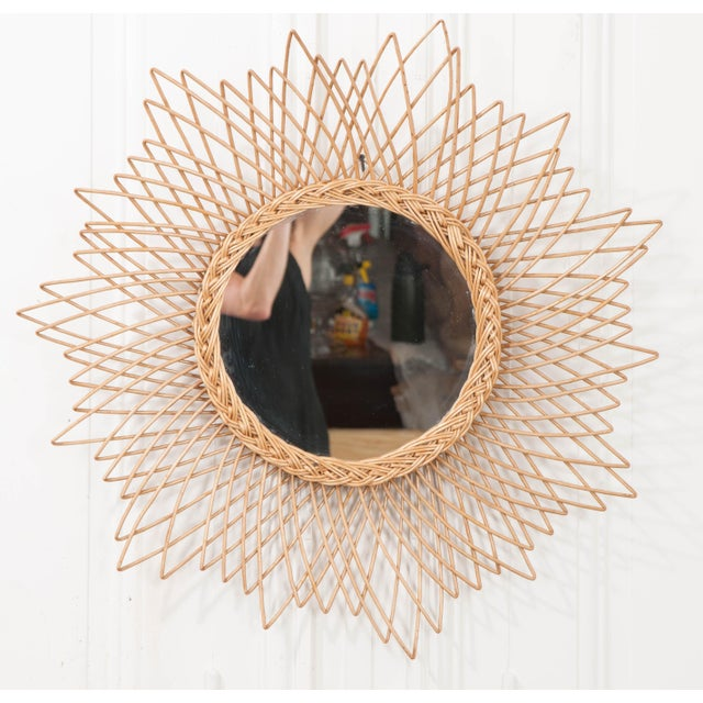 This fun vintage rattan sunburst mirror is from England, c. 1960's, and would add a touch of the eclectic to any interior!