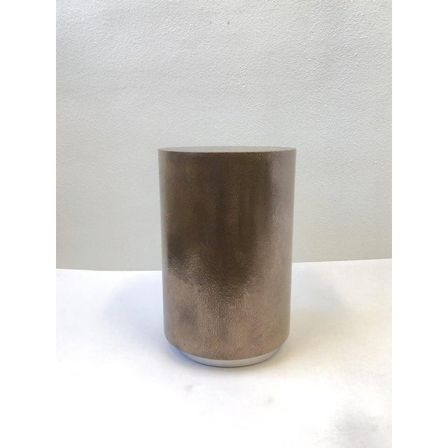 A 1980s drum occasional table by Steve Chase. The table is constructed of wood with a custom texture aged bronze finish...