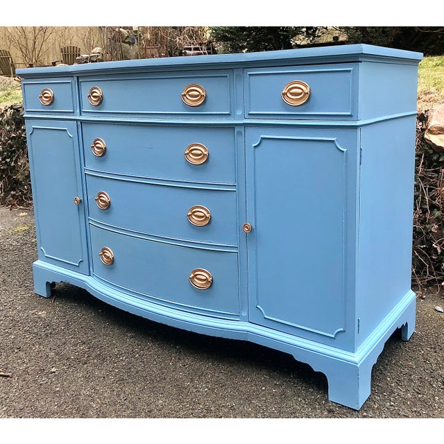 Classic Drexel Server from the New Travis Court Collection. Four center drawers flanked on each side by a cabinet with...