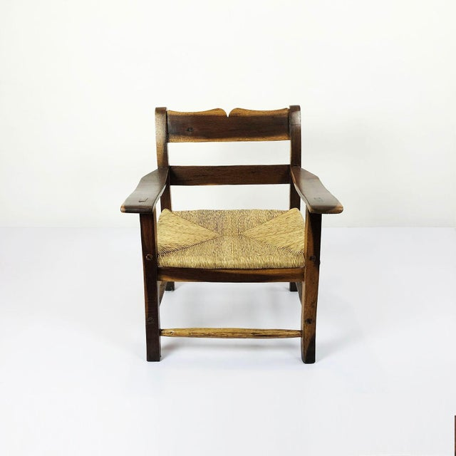 We offer this amazing midcentury Livingroom set in the style of Clara Porset in tropical wood and wicker seat, circa 1960.