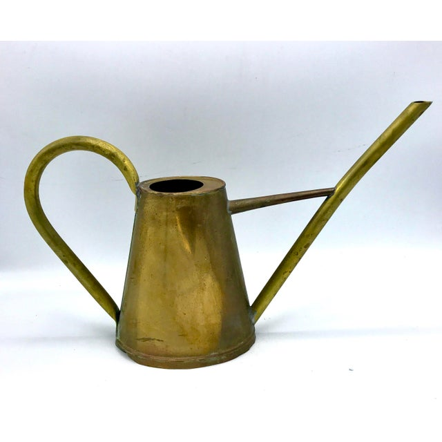 Lovely lines, extended spout, this brass watering can from the 1930s is charming from cottage to boho chic.