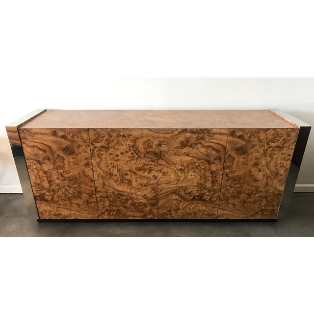 A stunning large credenza in the style of Paul Evans; this faux burl credenza has chrome accents and plenty of storage. A...