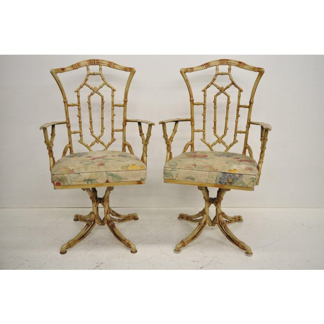 Vintage Metal Faux Bamboo Chinese Chippendale Style 5 Pc Dining Set with Swivel Chairs. Item features 2 armchairs, 2 side...