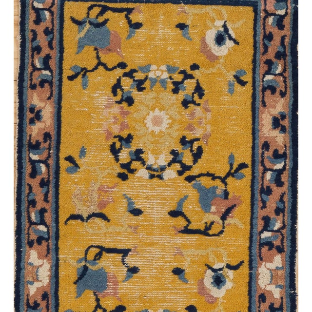 This authentic Ningxia rug has a brilliant, natural golden yellow field with three circular peony and leaf openwork...