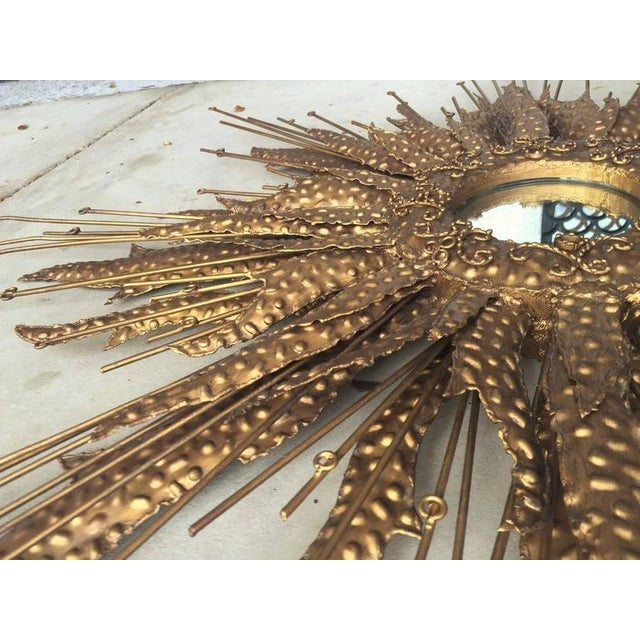 Brass sunburst Brutalist style circular mirror. This solid brass mirror shows wonderfully in any setting.