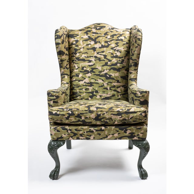 Vintage wing chair upholstered in Fortuny's Camo Isole in Army (#5743)