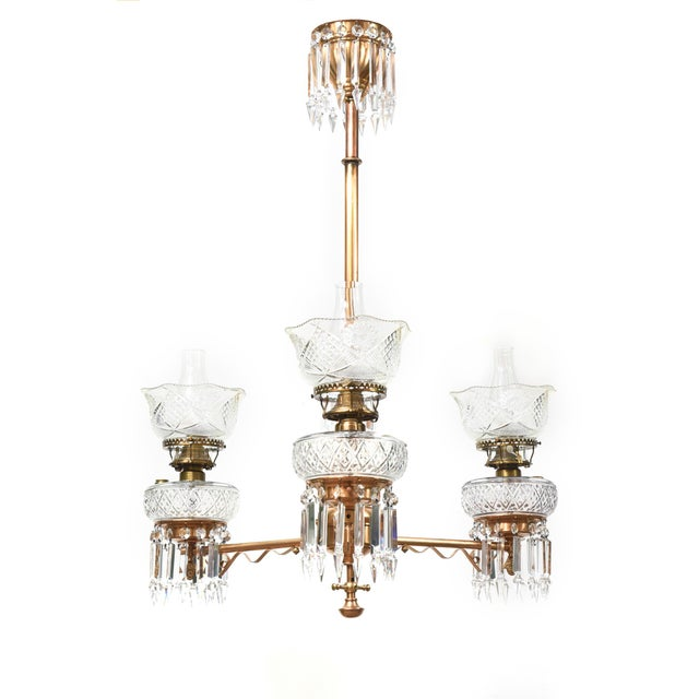 Three light oil chandelier with original oil fonts and shades. Completely restored and rewired, ready to hang. Can be...