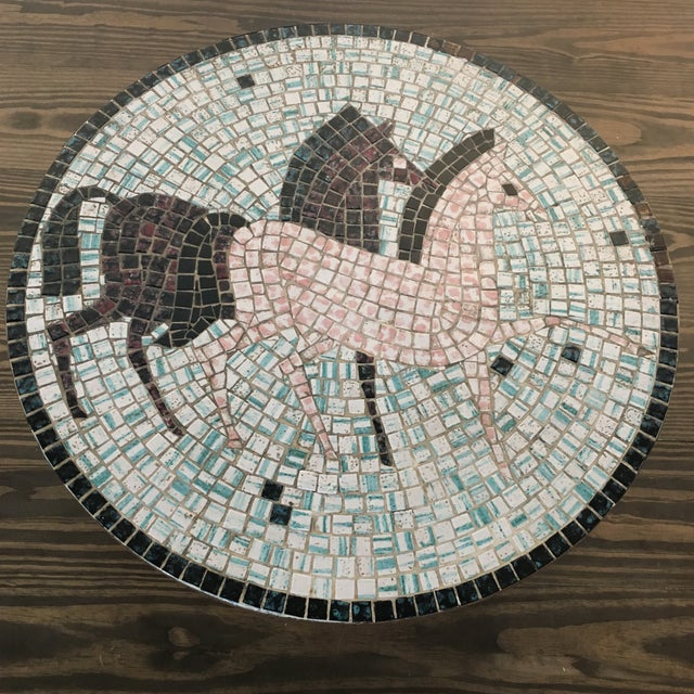 Such a special piece! A very rare find, this round Italian made Mid Century mosaic tiled coffee table, features a pair of...