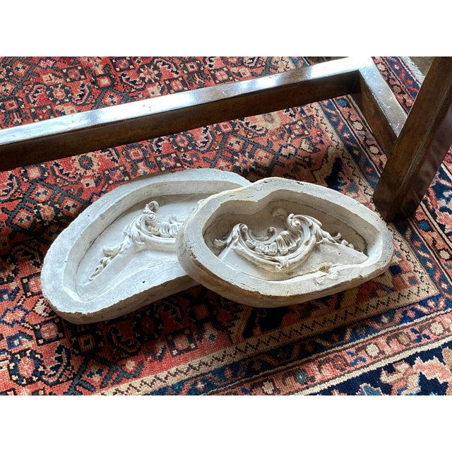 A pair of antique French casting molds that now make for a decorative accessory.