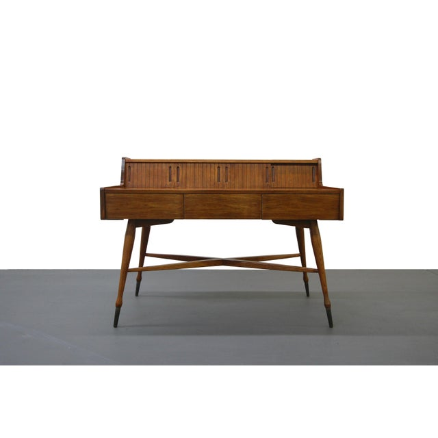 The perfect small space mid-century desk. Classic mid-century style and lines. Lots of character in the details. X shape...