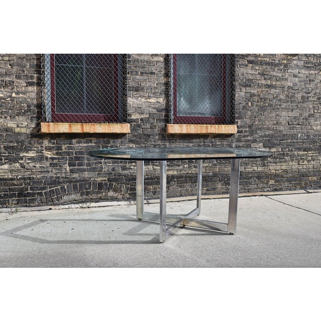 Classic 1970's vintage glass topped dining table with X- style chromed base. Very well made and substantial. Good overall...