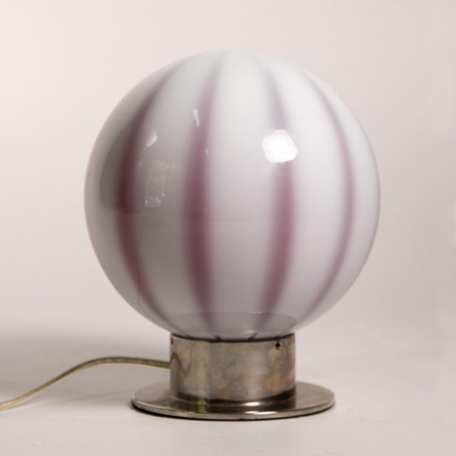 The Global Views Lamp has two distinct appearances and colors, when the lightbulb is on and when the lightbulb is off. The...