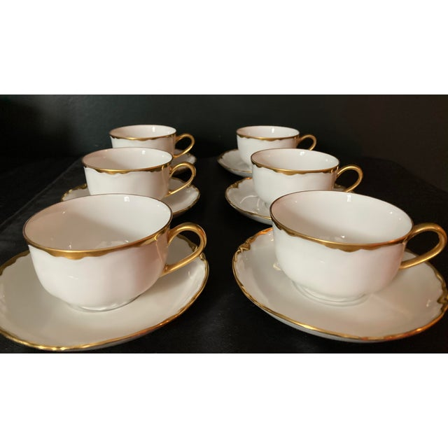 Vintage Hutschenreuter White porcelain cups and saucers with gold rims. Saucers are scalloped. Made in Germany Excellent...