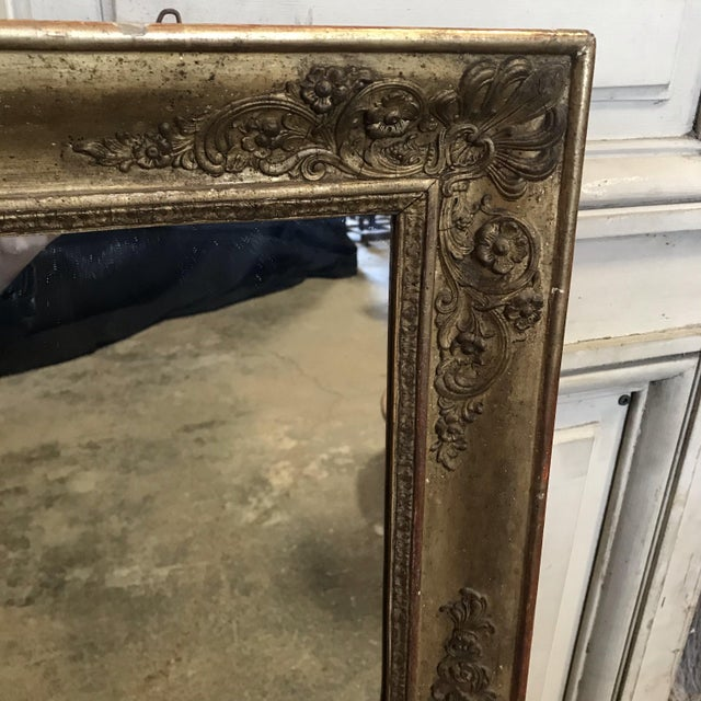 Classic early 19th century large giltwood mirror with pretty decoration on the frame and original wooden back. #3457.