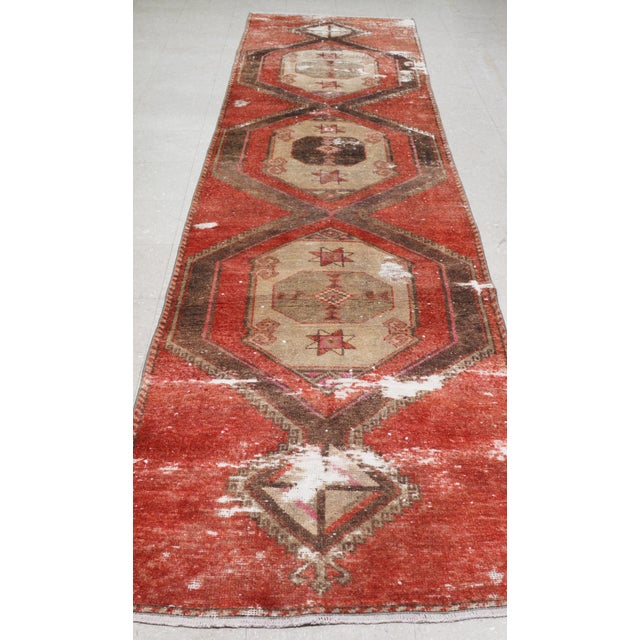 Vintage Kurdish runner rug with natural colors and soft hand spun wool with medallion pattern.