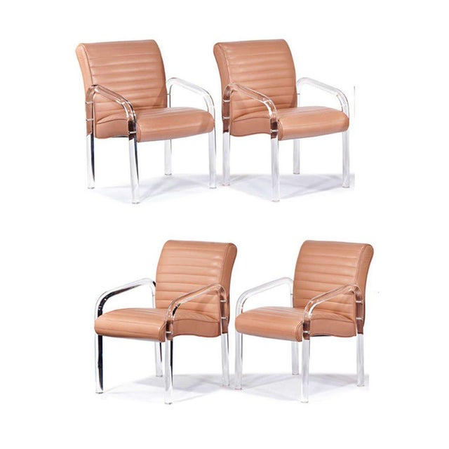 Six leather lounge chair with bent Lucite by Leon Frost for the Lion in Frost Company, circa 1975. We have two more...