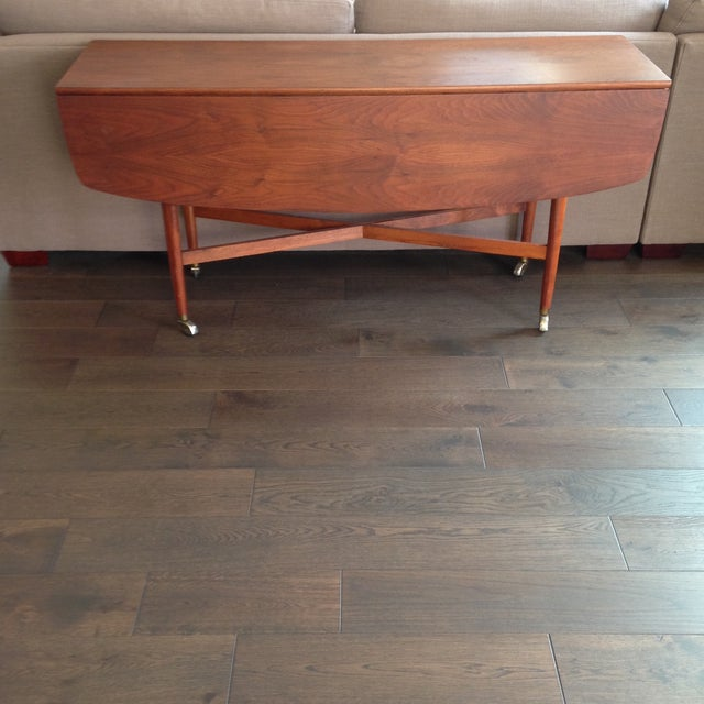 This gorgeous mid century piece by Drexel is made of solid walnut with brass casters (original pad feet are attached on...