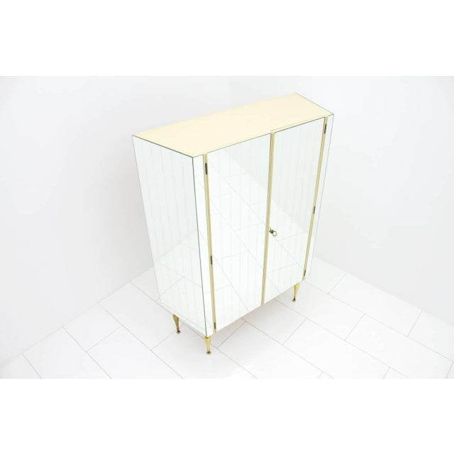 Fully front mirrored wardrobe with beautiful brass legs, Germany 1960s. Goof condition. Worldwide shipping.