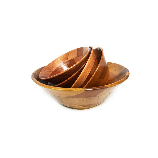 Vintage mid century set of 5 hand crafted wooden serving bowls. The set includes one large serving bowl and four smaller...