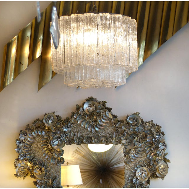 Offered for sale is a dense Venini blown glass pendant chandelier. The fixture has two levels of blown glass tubes which...