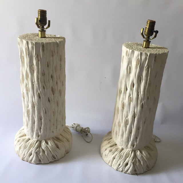 Beautiful pair of large white plaster lamps in the manner of John Dickinson. Their tree trunk motif gives a rustic feel to...
