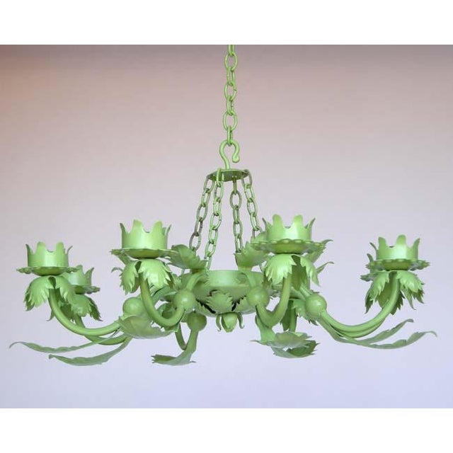 Whimsical apple green wrought iron chandelier with leaves. Can be electrified. Eight arms. Also comes in white, silver and...