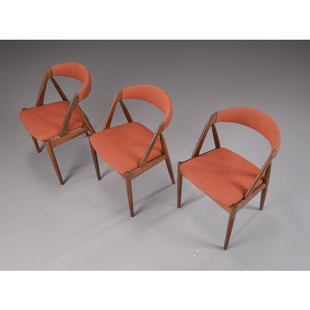 Three A-frame model 31 chairs designed by Kai Kristiansen for Schou-Andersens Møbelfabrik. Set of fined teak wood. Seat...