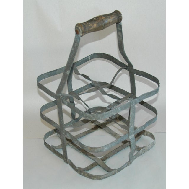 Circa 1930s French gray zinc metal bottle carrier with wood handle. Holds up to four standard size wine bottles. No...