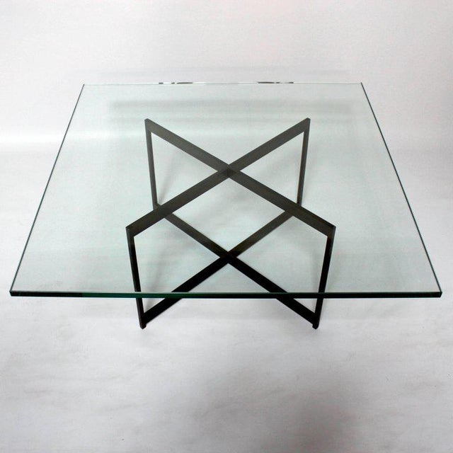 Mid-Century Modern bronze and glass X-base coffee table, in the style of Milo Baughman, Base is very heavy and solid, with...