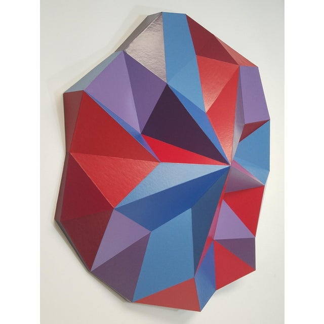 Wall sculpture made with illustration board (cardboard) and painted with acrylic and spray paint.