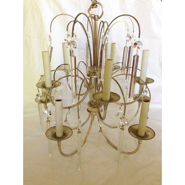 Vintage Gaetano Sciolari chrome and crystal chandelier. Stunning when lit. Tiers of crystals in 2 sizes. The crystals are...