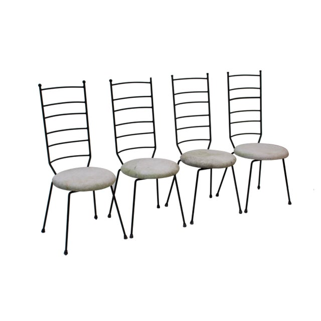 Set of 4 wrought iron Ladder Back Patio Dining Chairsi. These are in the style of Arthur Umanoff or Salterini and have...