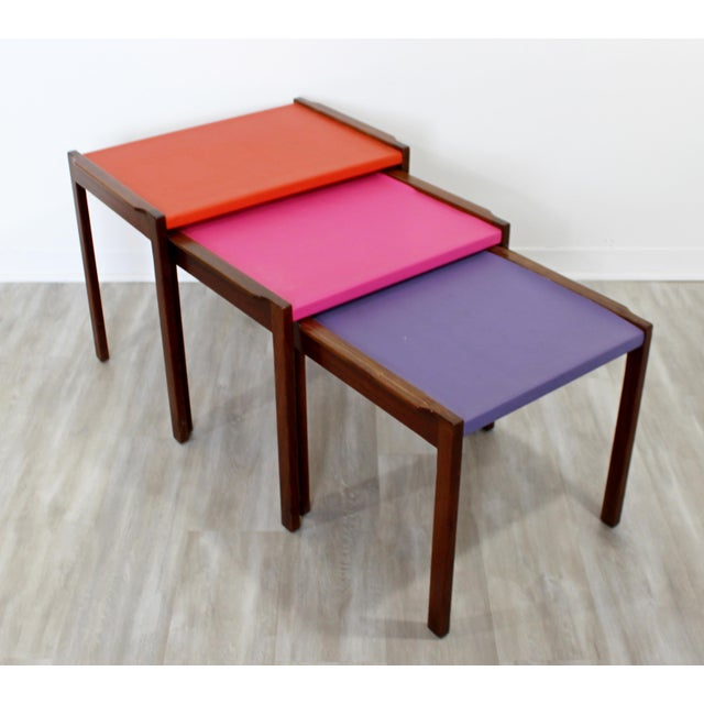 For your consideration is a fabulous and fun set of three nesting tables, made of walnut and multi-colored vinyl tops, by...