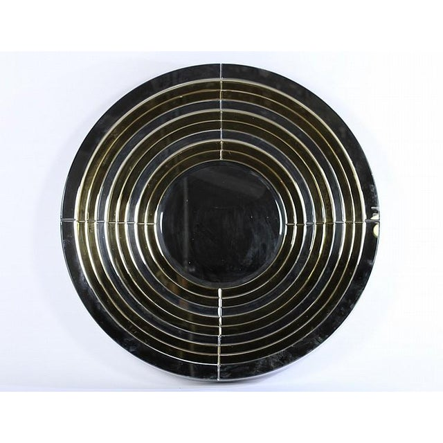 This stunning Mid-Century Modernist mirror features a grandiose round segmented design with alternating bands of clear and...
