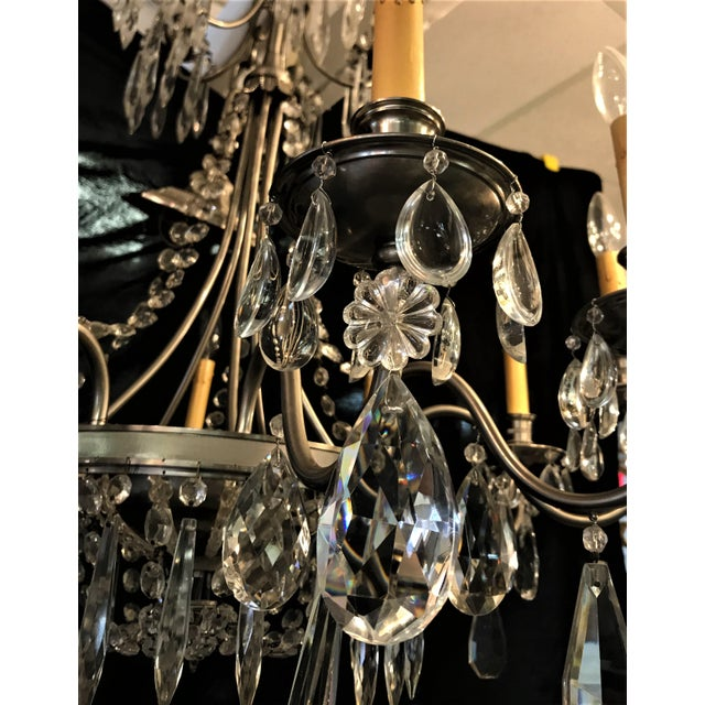 Very unique vintage chandelier! This large ten arm chandelier has a a nickel finish with many unique crystal adornments....
