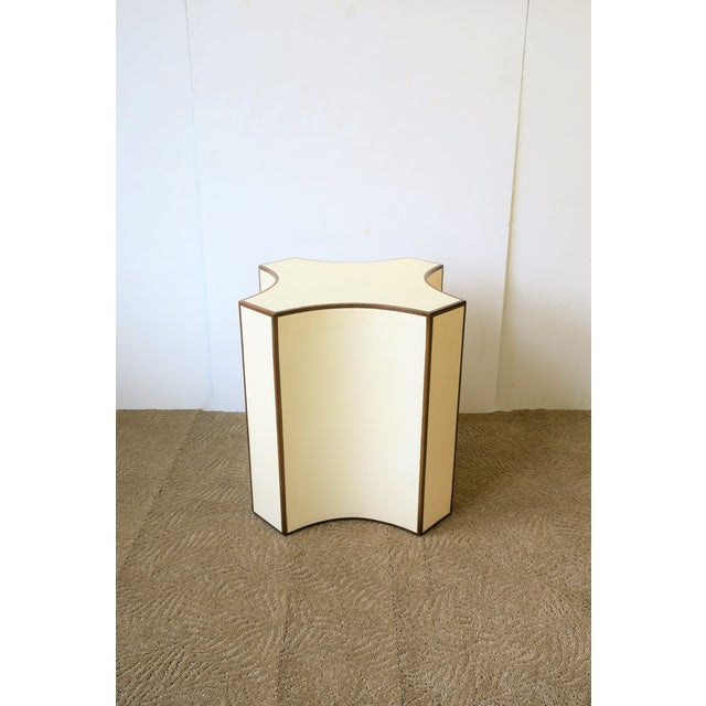 A beautiful geometric shagreen-esque (faux shagreen) side or drinks table in an off-white or cream hue, complimented with...