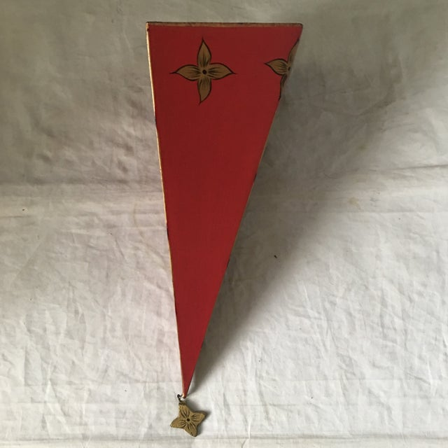 Contemporary Moroccan style red tole metal wall mounted shelf with gold accents and hanging gold metal medallion on bottom...