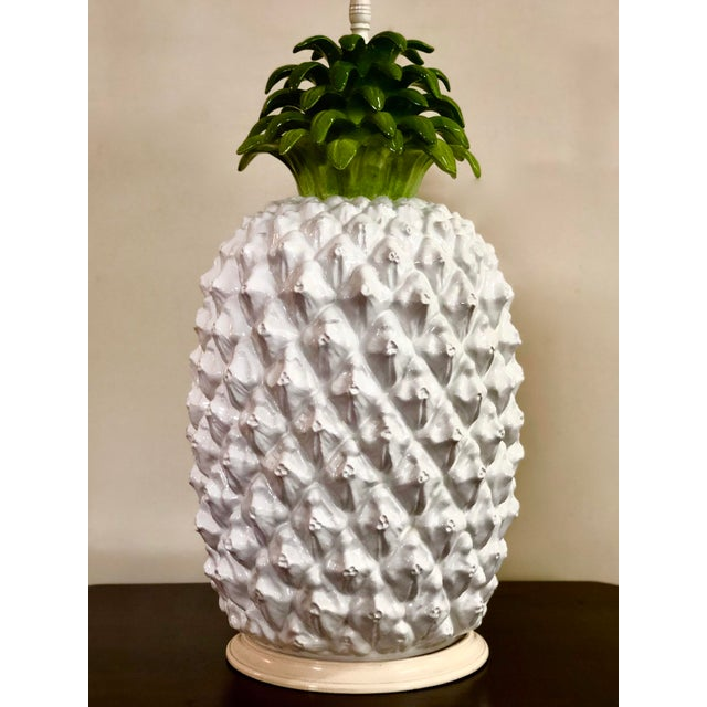 Italian majolica pineapple lamp base, no shade. The total height is 26 inches while the ceramic body is 19 inches tall and...