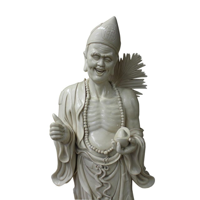 Ji Gong - he was a popular Chinese god / deity from the folk story. He carries a bottle of wine and a fan as his image. He...