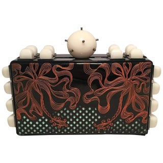 Tonya Hawkes Black Patent Leather Laser Cut and Etched Orange and Teal Clutch For Sale