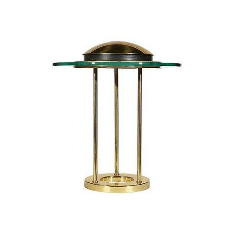 Glass disc and gilt metal table lamp designed by Robert Sonneman for George Kovacs. Wired for the US and in working...