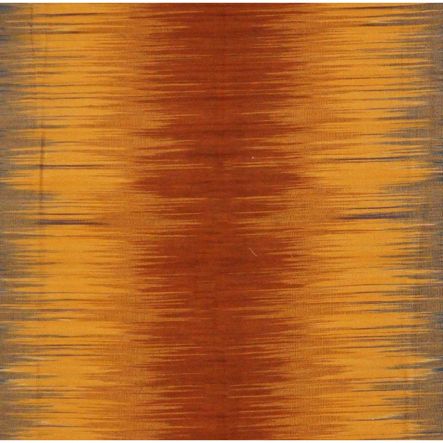 This beautiful rug is handmade, made in India. It features a pattern in a vibrant combination of orange,navy, and red....