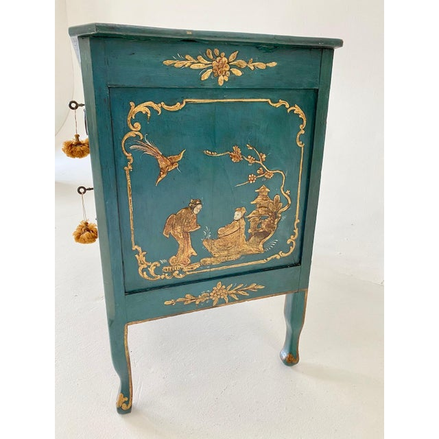 Exceptional 18th c. Venetian commode/lowboy embellished with hand lacquered chinoiserie detail. Two drawers, each with a...