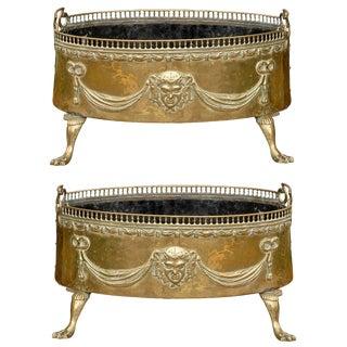 Pair of Dutch 1820s Jardinières with Repoussé Brass Décor and Paw Feet