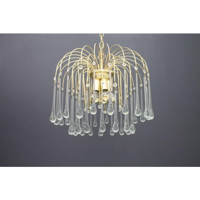 Christoph Palme Waterfall chandelier gilded brass and glass drops in different height, Germany, 1970s Very good condition.