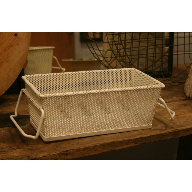 Great vintage metal storage baskets from France. Very industrial, painted with and made of mesh metal with sturdy handles....