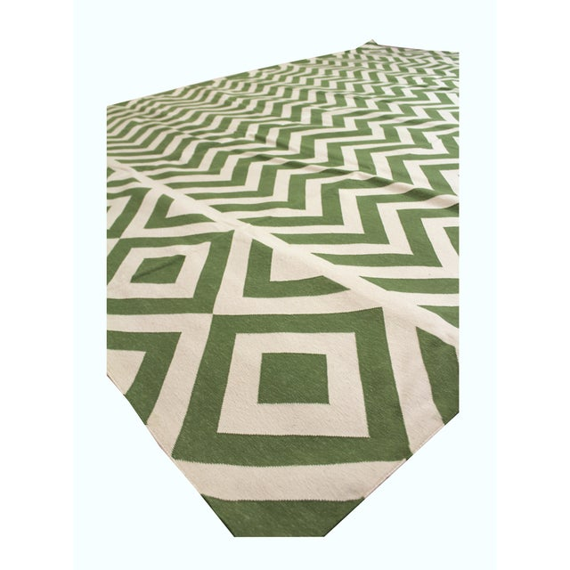 """Item: Madeline Weinrib """"Lupe"""" area rug in green. Size: 9' x 12' 100% cotton flat weave area rug, hand-woven in India...."""